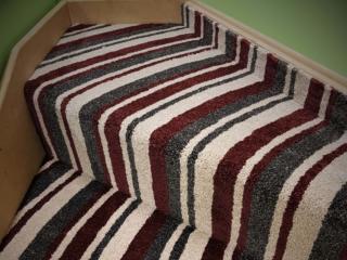 Curved carpet winders