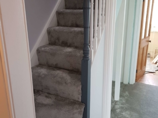 Staircase carpet fitting