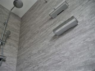 Shower walls tiled with LVT