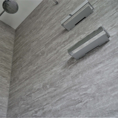 Shower walls tiled with LVT